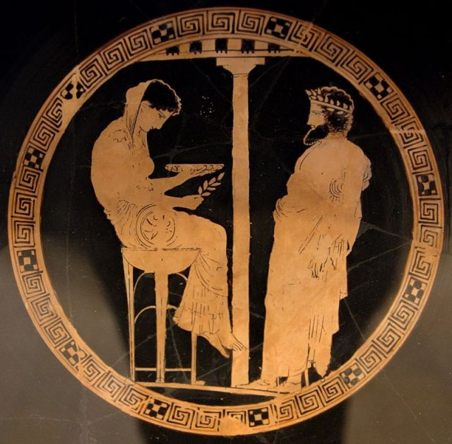 """Around 440 BCE, an Athenian potter decorated a large cup with a portrait of the Delphic Oracle in the midst of a prophetic session. It turns out to be the only surviving image that we have of the Pythia from her own day. The illustration shows neither a rustic maid nor a youthful seductress. Rather, it portrays a woman in her prime, with full breasts and supple gracefulness, her long alb coming down to her ankles. She sits on the tripod, her bare feet dangling off the floor, her body slumped, not quite herself, thoughtful, her eyes gazing down, looking into a small dish, presumably filled with water from a sacred spring, perhaps fragrant with a sweet aroma. In her right hand she holds a sprig of laurel, Apollo's holy plant. The ceiling of her oracular chamber is low, and beneath her feet, below the floor, the artist has depicted a void."" William J. Broad"